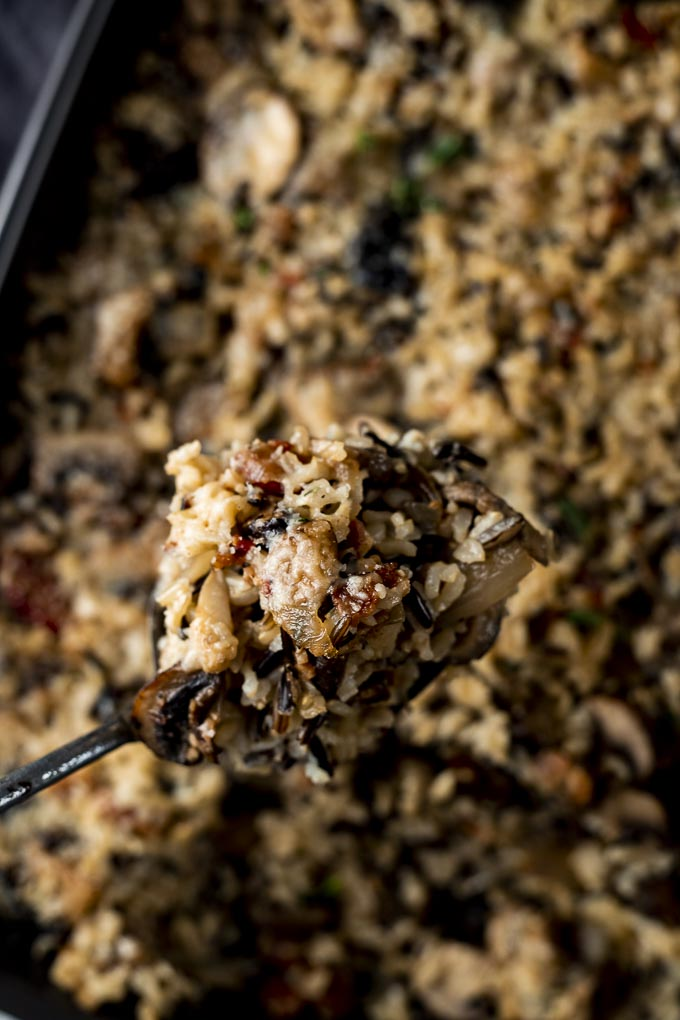spoon full of wild rice stuffing with mushrooms