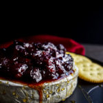 cranberry chutney on baked brie with crackers