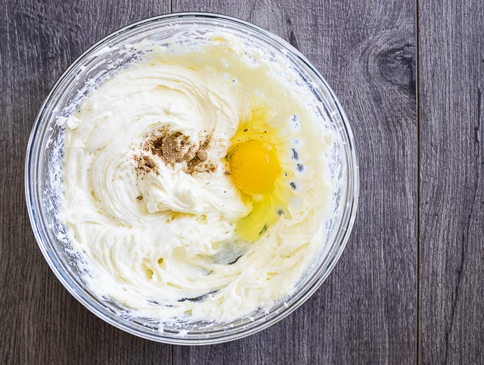 whipped cream cheese with egg and nutmeg in a bowl