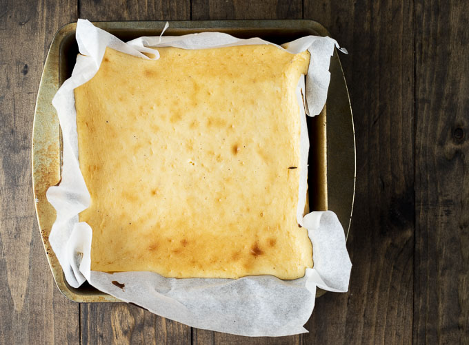 baked cheesecake in a square pan
