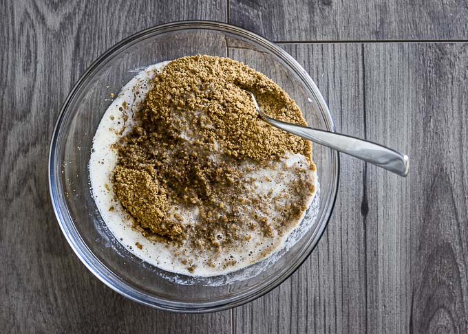 gingersnap crumbs and butter in a bowl