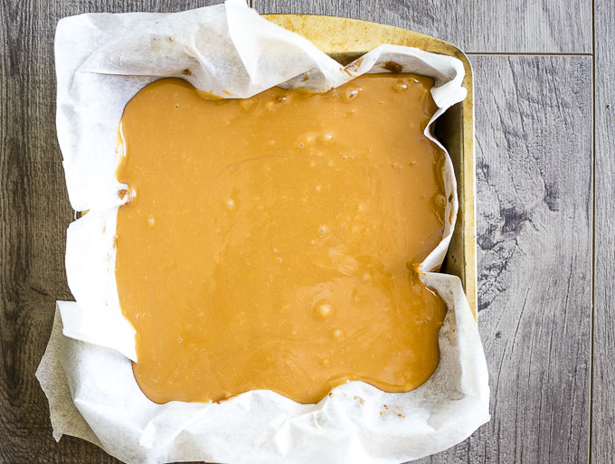 caramel covered shortbread crust in a pan