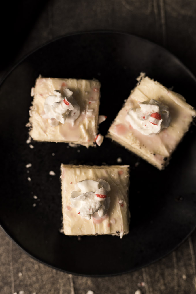 3 peppermint cheesecake bars on a plate