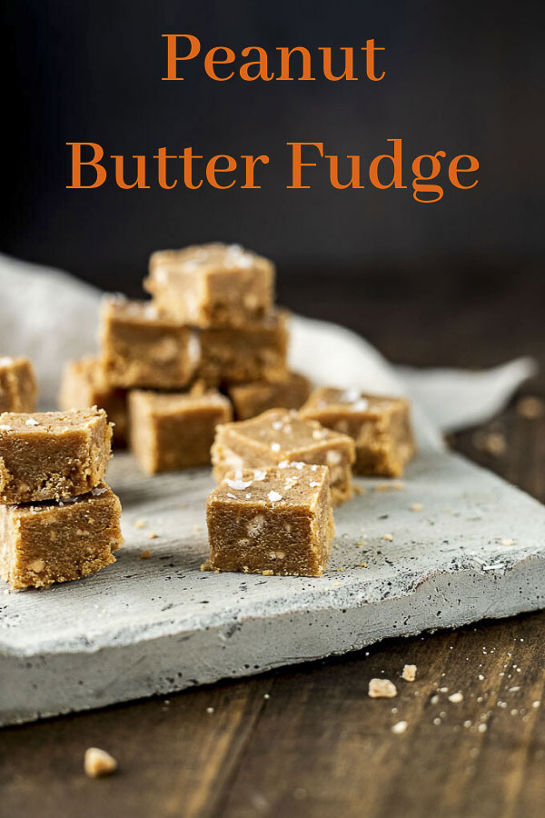 This is the Best Peanut Butter Fudge Ever. It\'s rich, creamy, studded with crunchy toffee bits and sprinkled with just a touch of salt for ultimate flavor. This easy peanut butter fudge recipe is made in just 5 minutes and is so addictively sweet, creamy and delicious. This fudge would make the most awesome holiday or birthday gift and is also great at parties and potlucks! #wenthere8this #peanutbutterfudge #homemadefudge #fudgerecipe