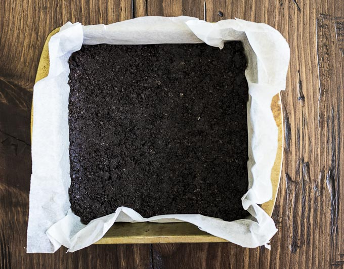Oreo crust in a baking pan