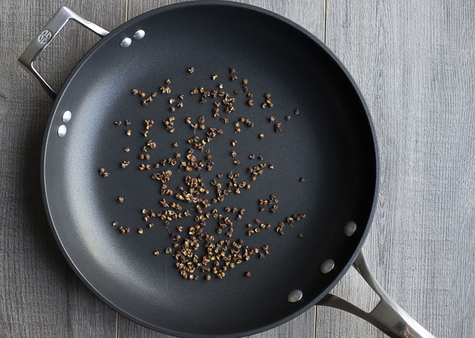 sichuan peppercorns in a skillet