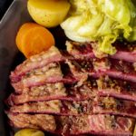 corned beef with cabbage, carrots and potatoes on the side