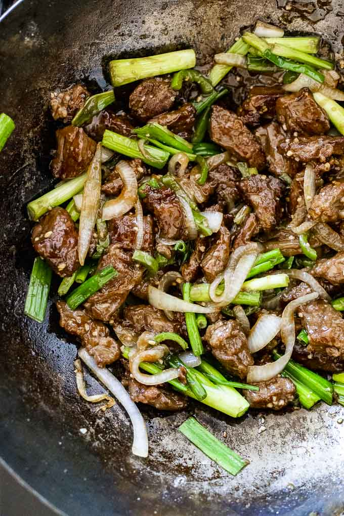 stir fried beef in a wok with vegetables