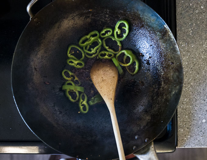 green peppers in a wok