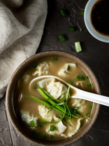 bowl of wonton soup with soup spoon