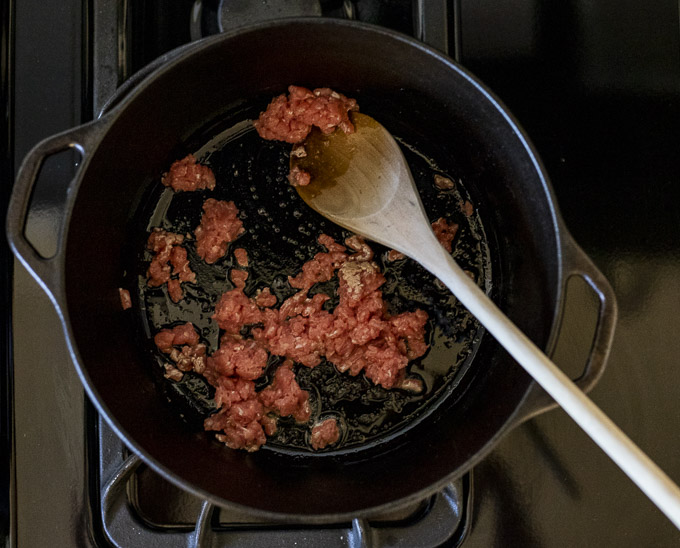 ground pork cooking in a large pot