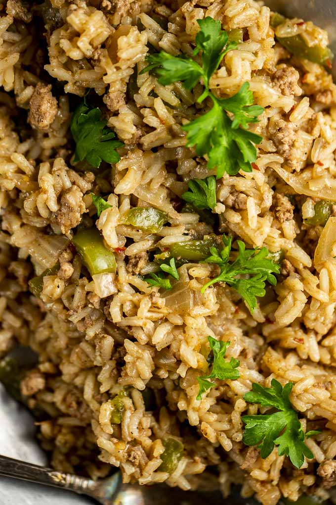 close up photo of dirty rice with parsley