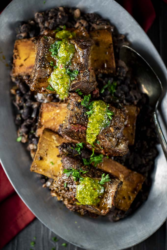 beef short ribs over black beans with green sauce