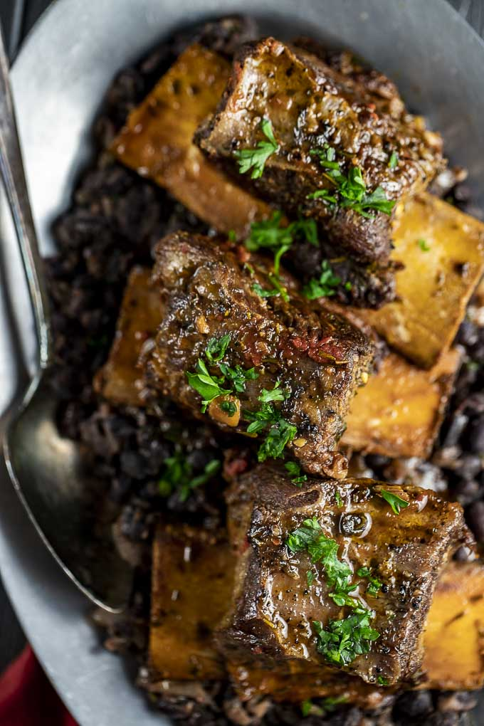 close up of instant pot beef short ribs with parsley on top