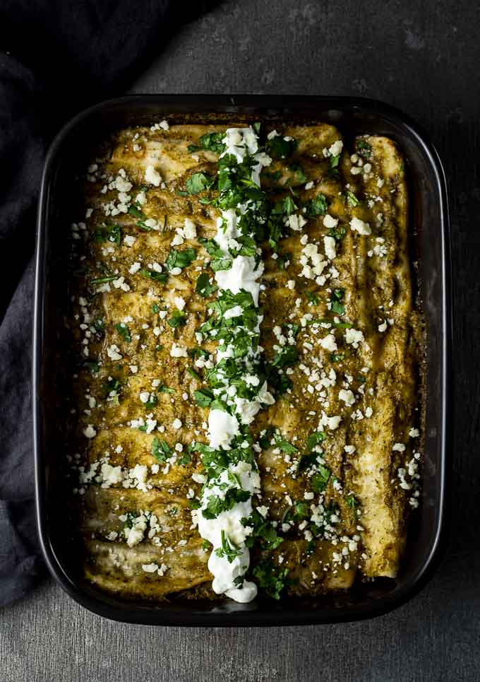green enchiladas in a baking dish