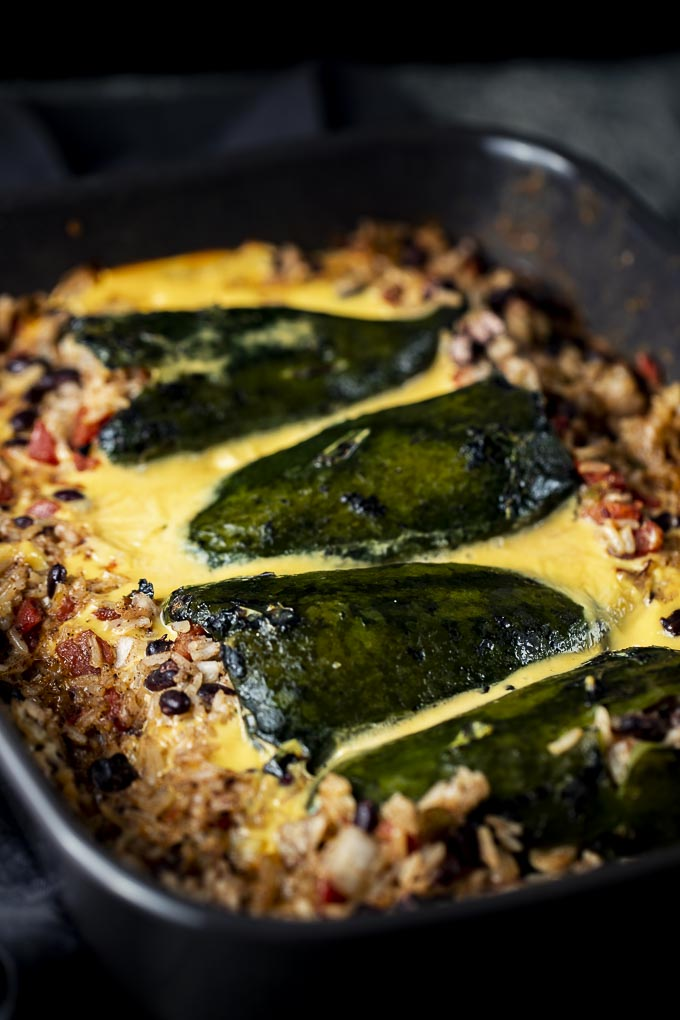 baked stuffed poblano peppers with cheese sauce