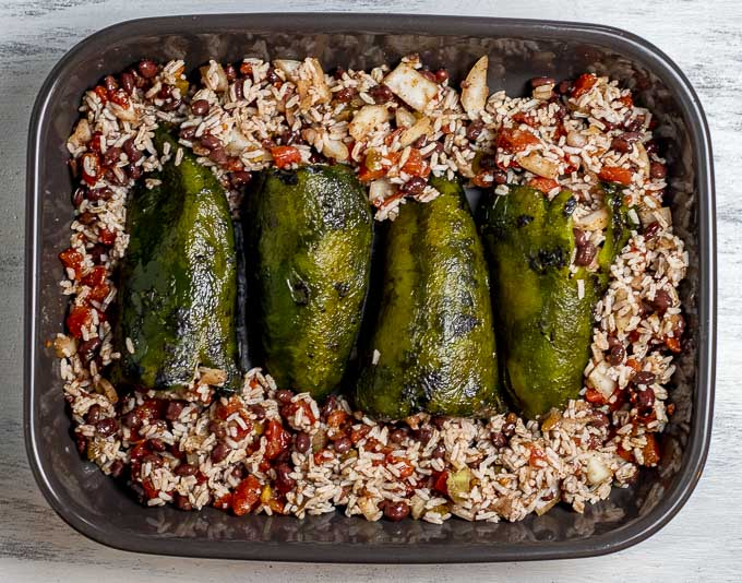 stuffed poblano peppers in a baking dish