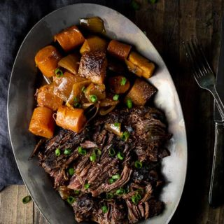 beef, carrots and potatoes on a plate