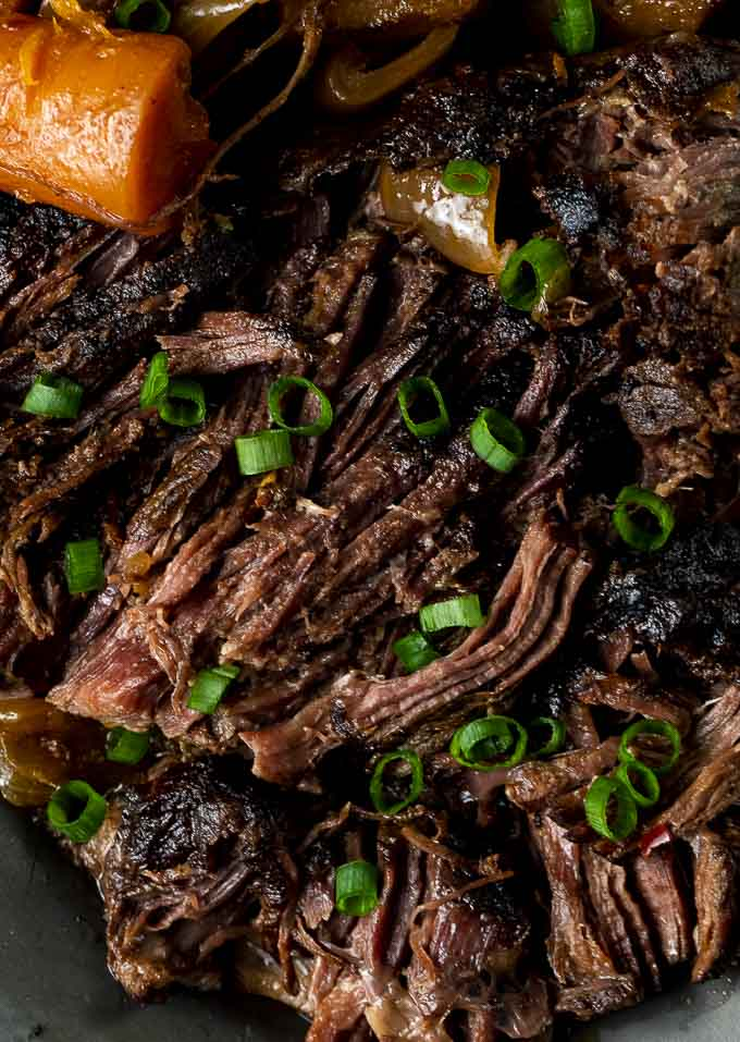 shredded beef pot roast on a plate