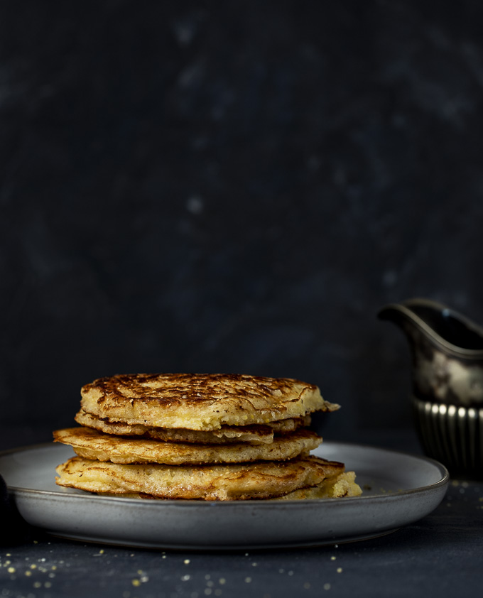 stack of cornmeal pancakes on a plate