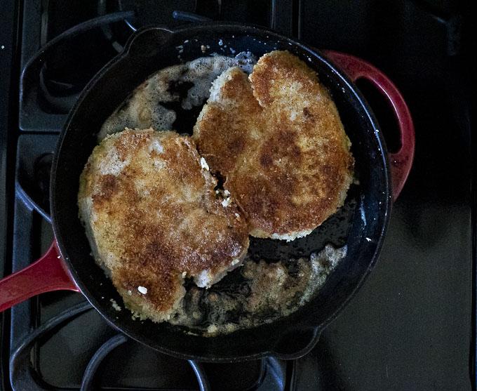 fried pork chops in a skillet
