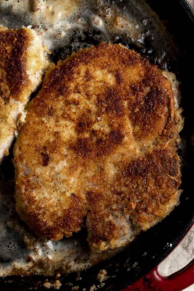 golden fried pork chop close up photo