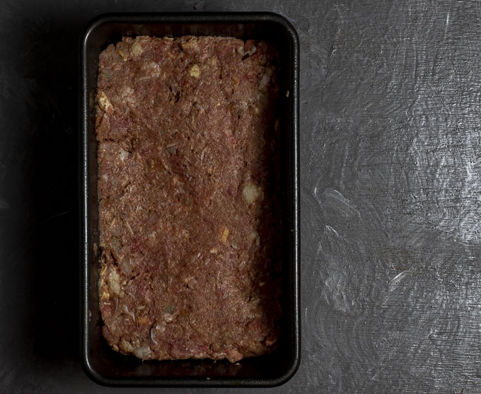 raw beef mixture in a loaf pan