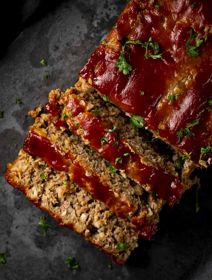 sliced pieces of meatloaf on a platter