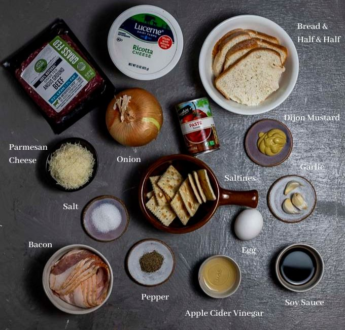 ingredients for meatloaf on a board with titles