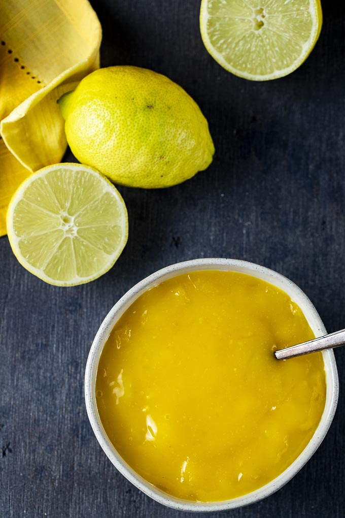 bowl of lime curd with a spoon