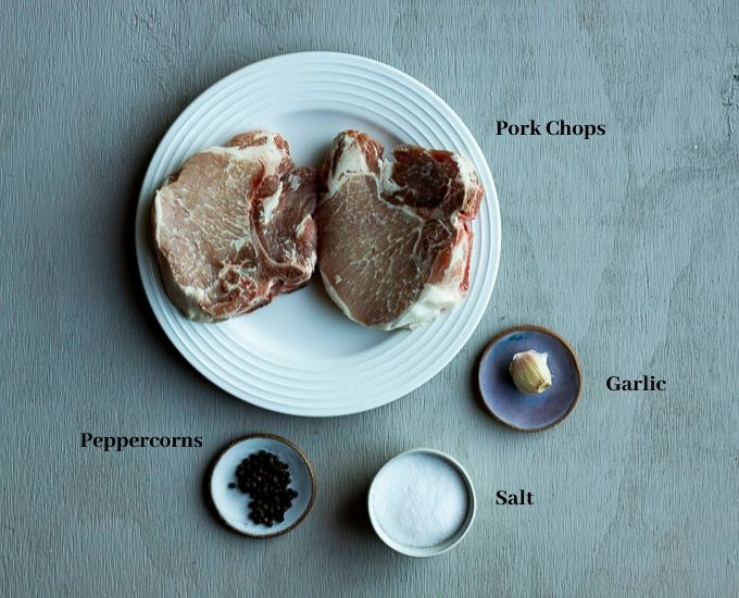 ingredients for pork chops on a surface with names