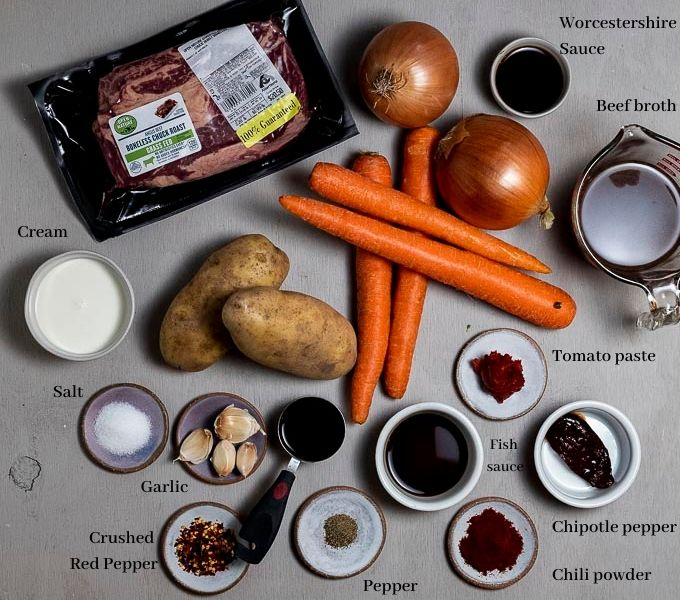 beef pot roast ingredients on a surface