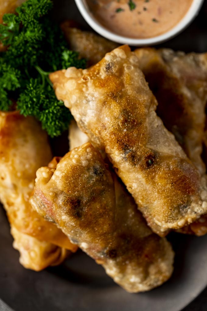 close up photo of several fried egg rolls