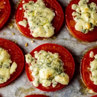 blue cheese on a tomato slice