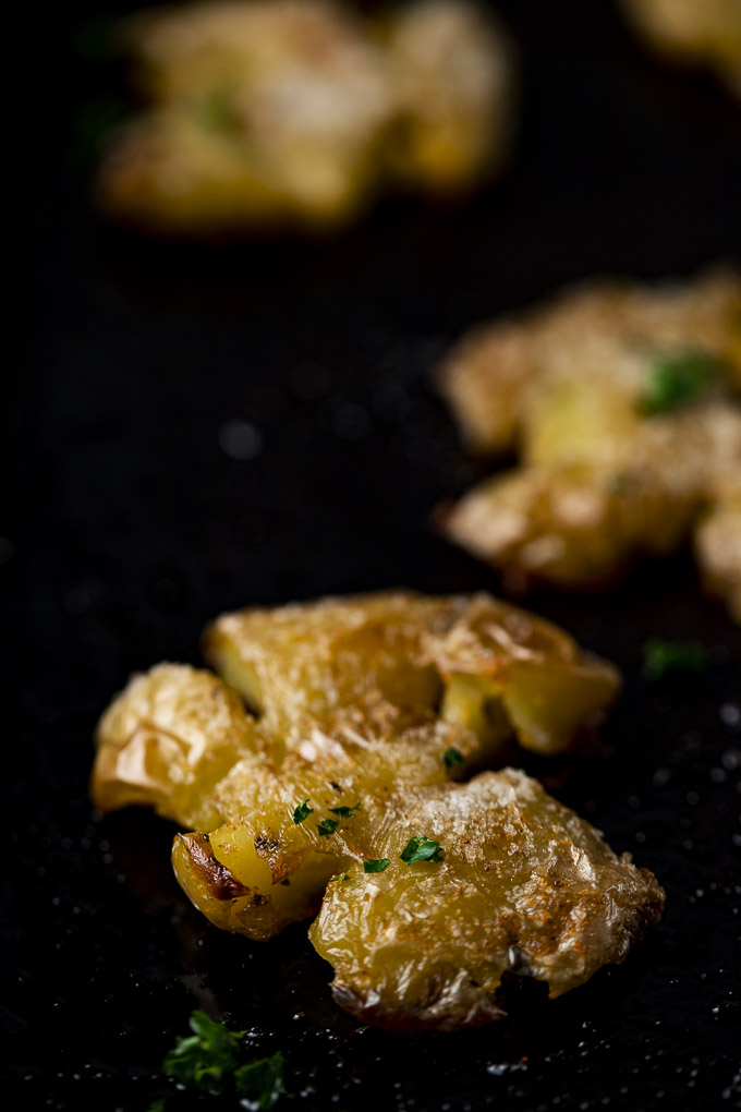 smashed potato up close with parsley garnish