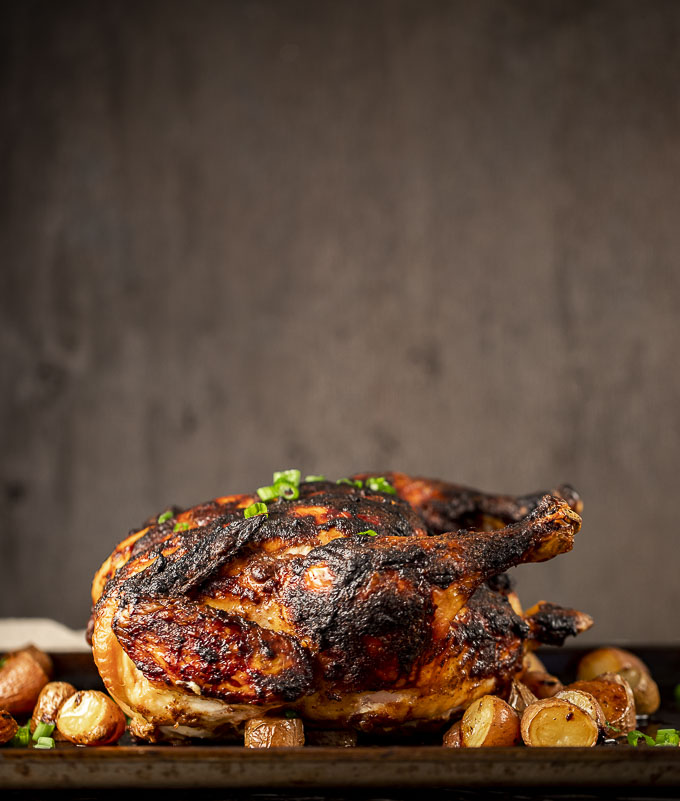 side view of a roasted chicken