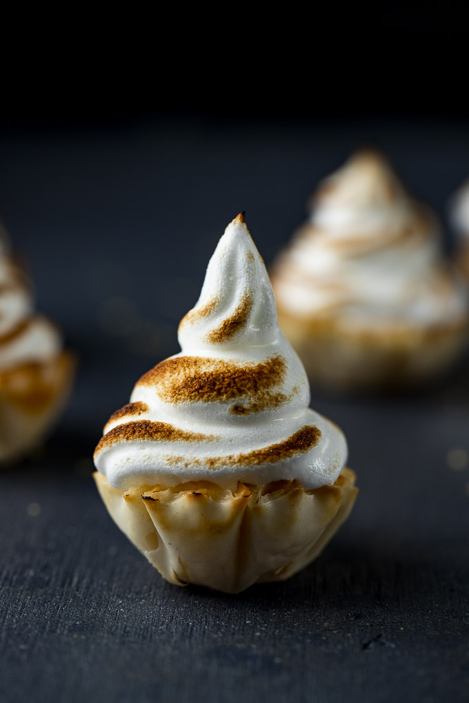 mini pastry cup topped with toasted meringue