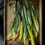 roasted leeks on a baking tray