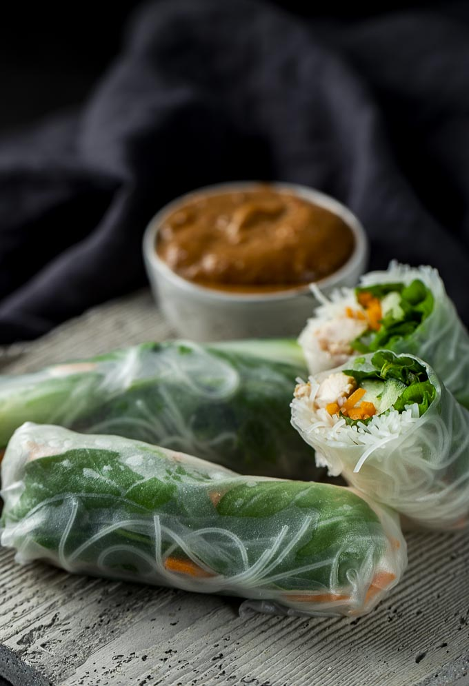 summer rolls on a plate with dipping sauce
