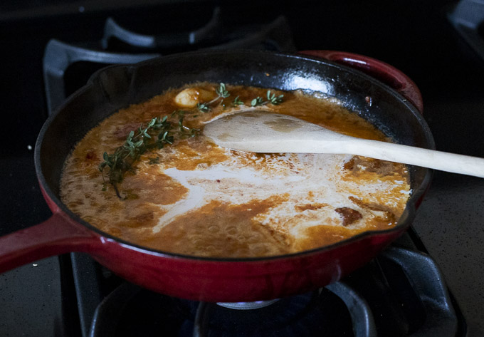 orange sauce with cream in a skillet