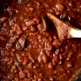 marinara sauce with a wooden spoon