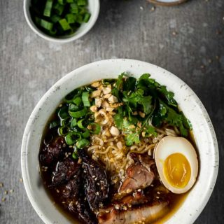 bowls of ramen with pork, noodles, egg and vegetables