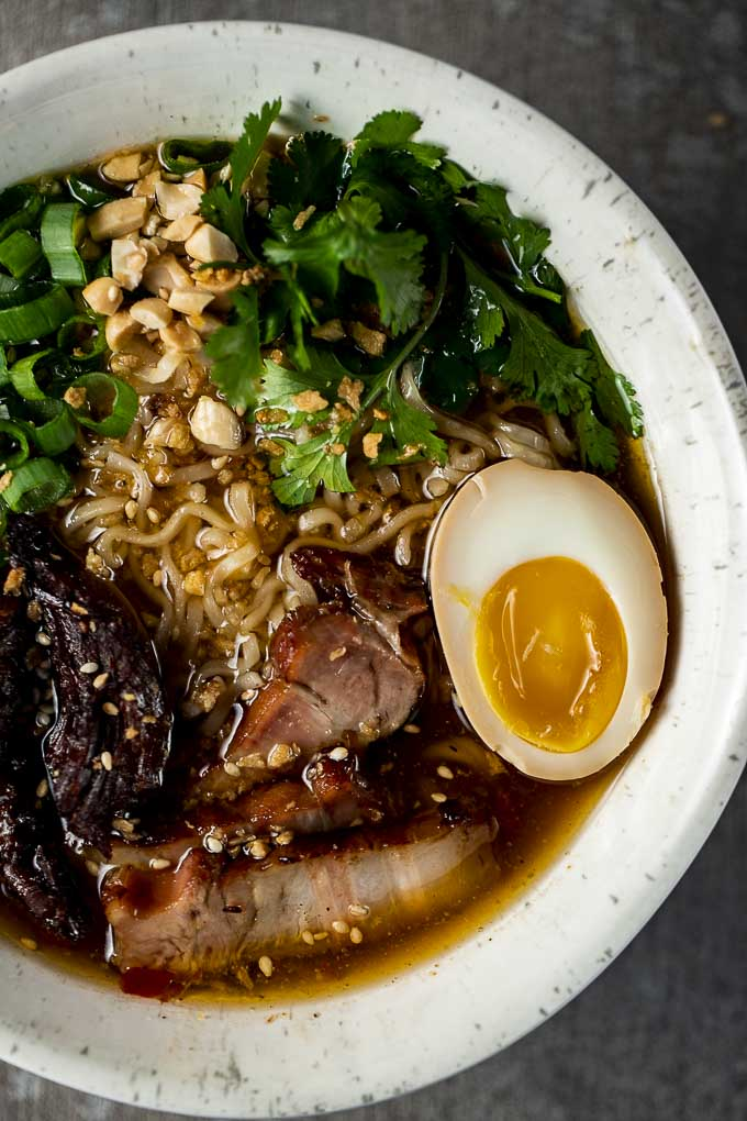 pork, egg and noodles in a bowl with broth