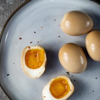 soft boiled marinated eggs on a plate
