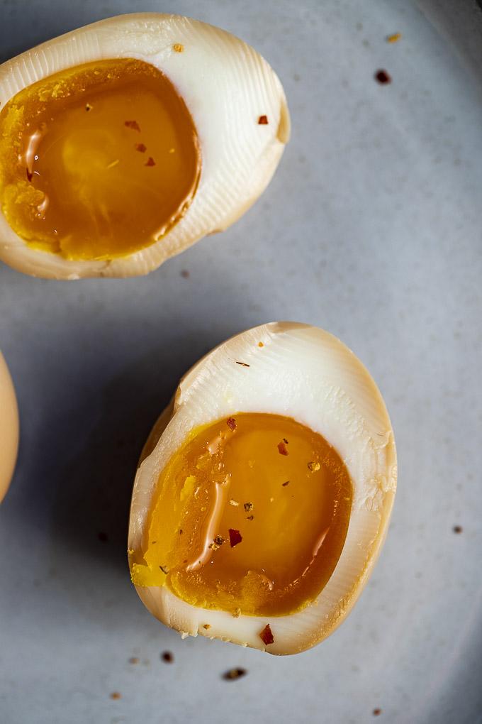 soft boiled ramen egg on a plate (halved)