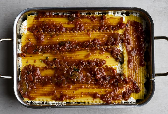 lasagna noodles covered in sauce