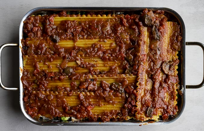 uncooked lasagna in a baking dish