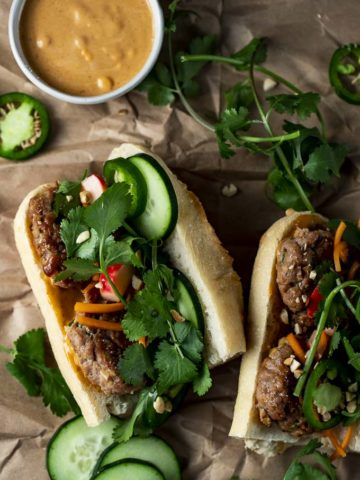 baguette with meatballs, vegetables and fresh herbs inside