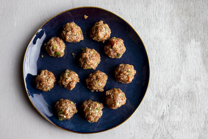raw meatballs on a plate