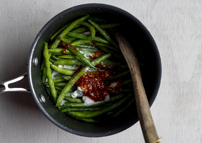 green beans in a saucepan with chili paste